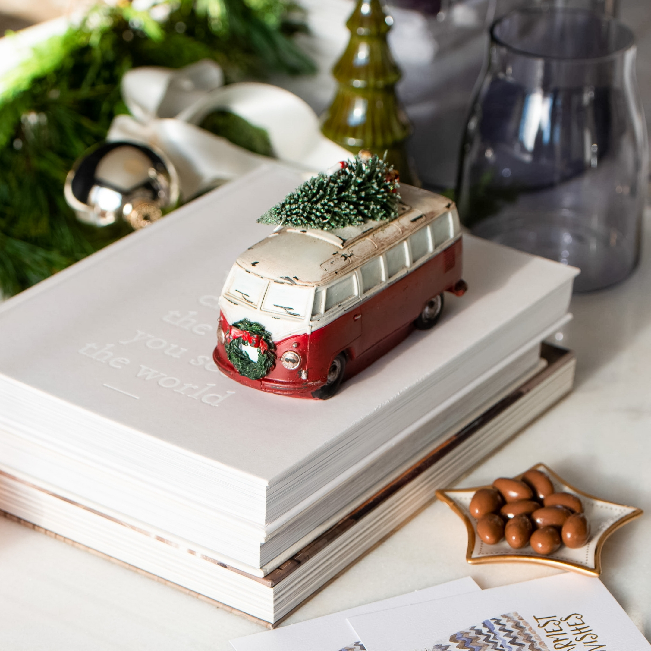 Christmas Inspired Image showing a red and white van carrying a Christmas tree ornament